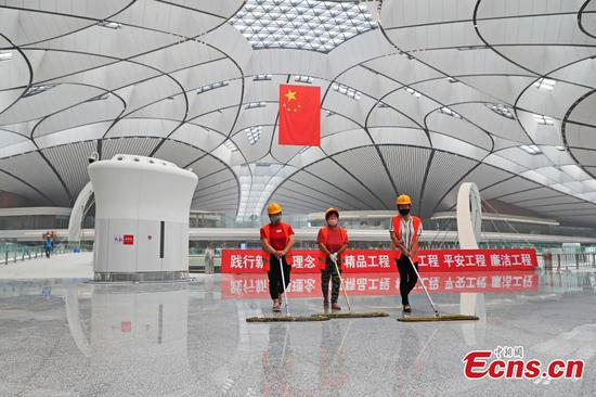 Workers debug devices at the terminal building of Beijing Daxing International Airport in Beijing, capital of China, June 19, 2019.  (Photo: China News Service)