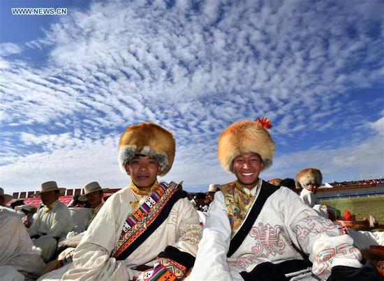 People wearing hats during horse racing festival in Tibet