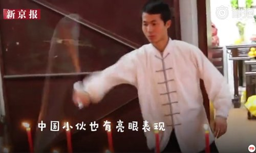 Chinese martial art master sets world record for blowing out candles with nunchaku