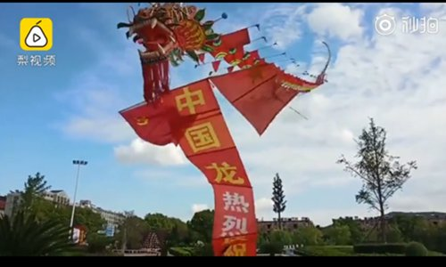 Elderly man makes 365-meter-long dragon kite for the National Day