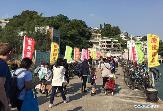 Flags to celebrate upcoming National Day seen at Lamma Island in Hong Kong