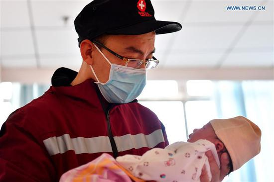 A new father bid farewell to family to aid novel coronavirus control efforts in Hubei