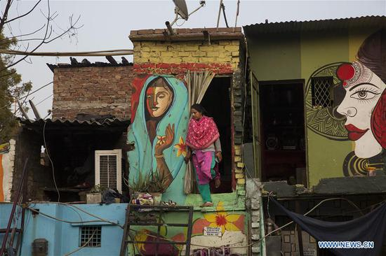 New Delhi slum given colorful makeover by local group