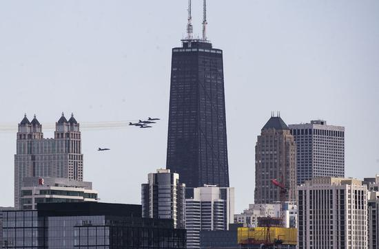 U.S. Navy Blue Angels fly over Chicago to salute health care workers